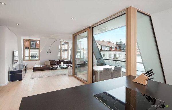 Зонирование гостиной комнаты при помощи  стеклянной стены