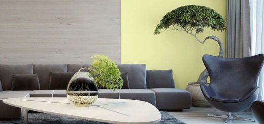Оливковые акценты отлично гармонируютс серой мебелью и стенами в гостиной