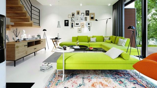 Ярко-зеленый диван, сочно-оранжевый, кресло и много естественного света